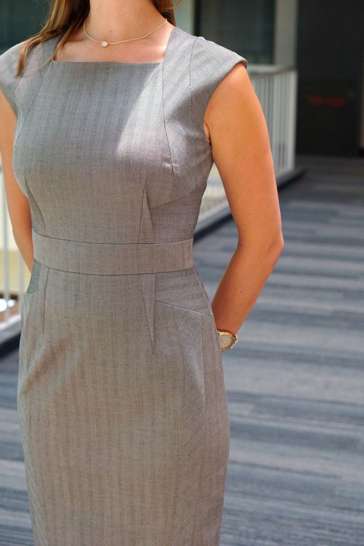 Skirt The Ceiling woman wearing grey sheath dress for business formal