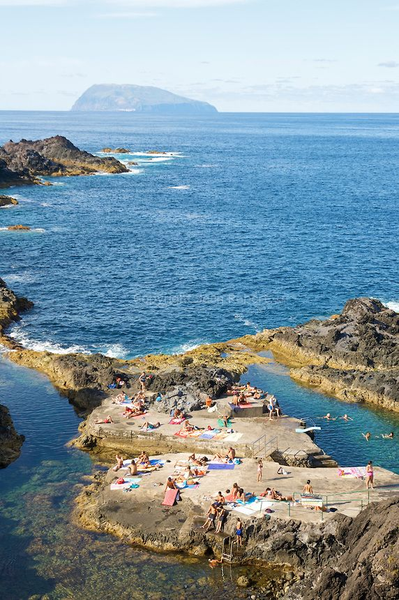 Natural swimming pool near Santa Cruz das Flores. Corvo island on the background. Portugal