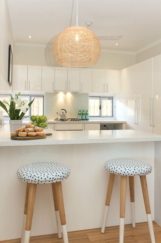 Kitchen - white, fresh and beachy with pendant detail and custom bar stools (SD Interiors)