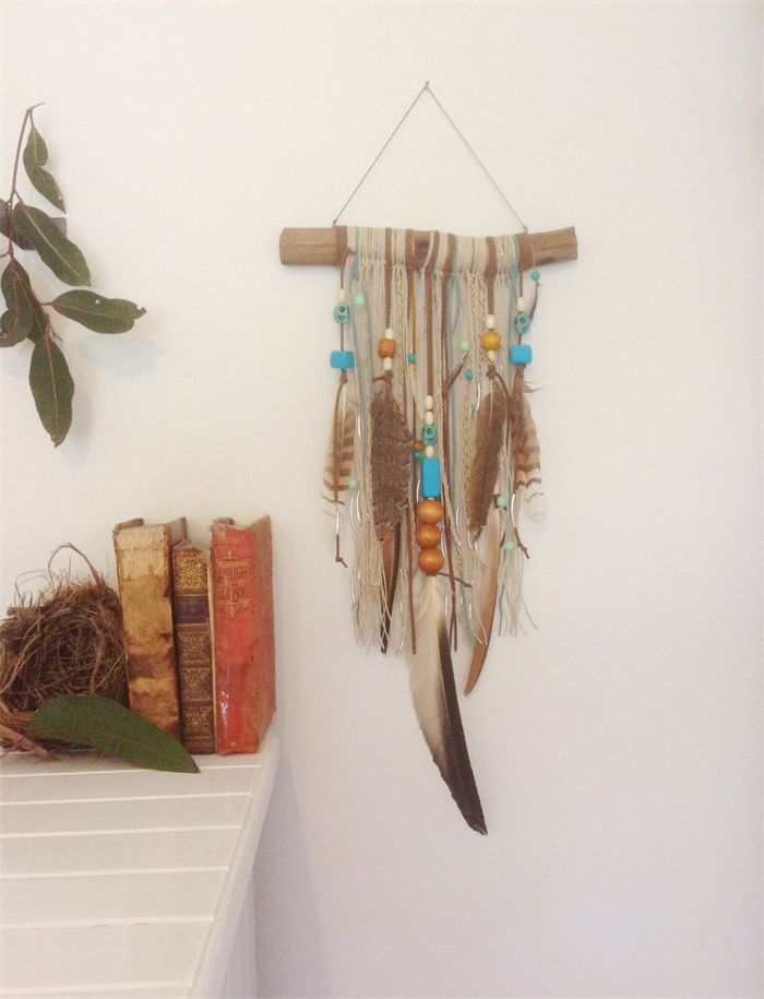 NEW IN STORE. WALL HANGING boho wood dream catcher with feathers beads & skulls.