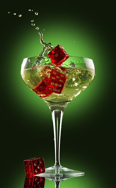 champagne glass and dice over green background - champagne glass alcohol splash party dice green