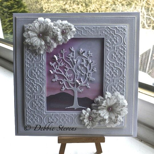 Spellbinders grand squares, Spellbinders 7.5 matting basics A, spellbinders d-lites flutter tree, heartfelt creations majestic blooms matching stamp and die, background scene is from inkylicious. Not sure what the embossing folder is called, think it was free with the ebosser machine by Debbie Stevens