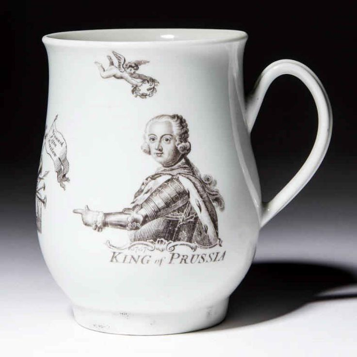 "Worcester porcelain mug dated 1757 commemorating Frederick the Great, having ""King of Prussia"" below portrait. Printed with ""RH"" monogram for Robert Hancock and anchor mark in design (4 5/8"" H)"