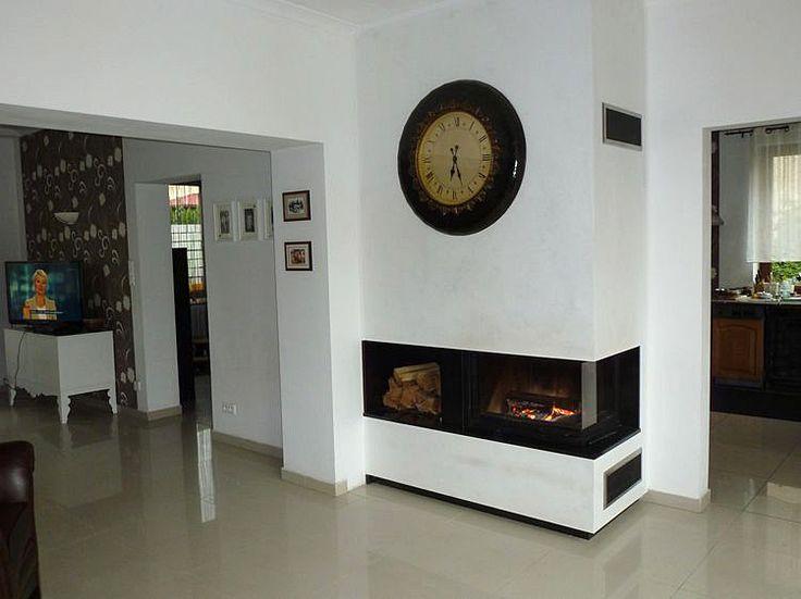 Modern fireplace with side window. Kominek nowoczesny z boczną szybą. #ModernFireplace #KominekNowoczesny #BocznaSzyba
