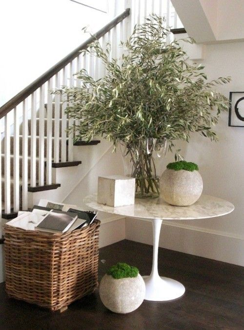 These concrete planters are awesome the saarinen table is beautiful the basket is very
