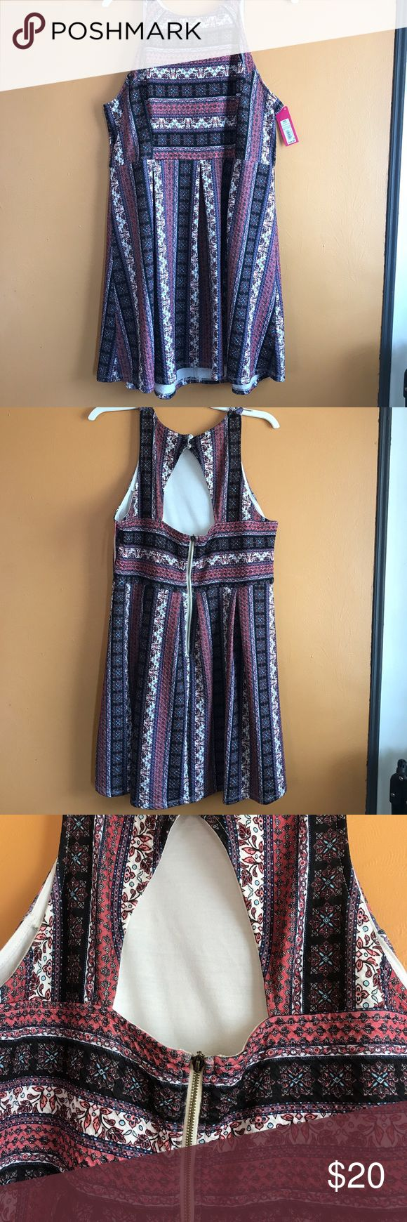 Brand new Aztek print cut out skater dress Brand new skater dress in ethnic tribal aztek print. Cut out on back. A-line shape. Perfect for summer wedding, party, girls night out. Textured fabric. Colors are burgundy, purple, blue and red. Dresses