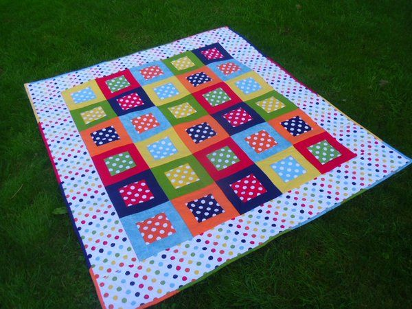 Sew this punchy FREE Dotty Squares Quilt by Karen Maxwell with Cotton Dots by Riley Blake Designs