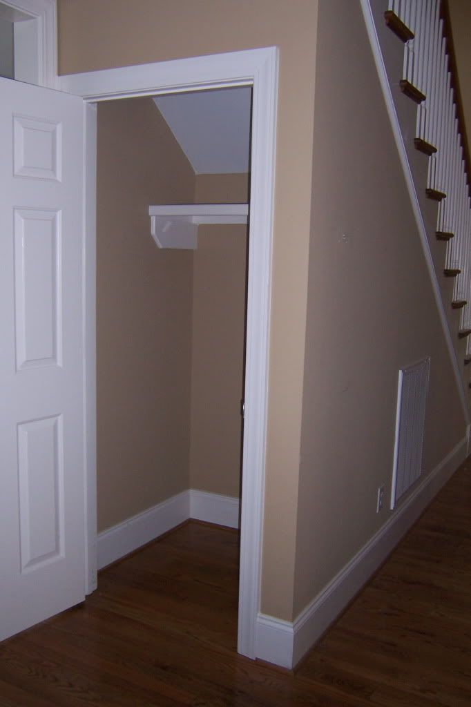 how come you don't find many houses with coat closets under stairs anymore. My grandma's hows always had one (it's on the side though). either way great idea.