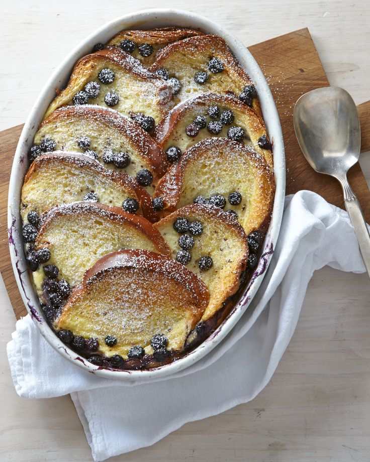 Baked Blueberry French Toast -- Juicy blueberries hide between layers of custardy French toast in this delicious make-ahead brunch dish.