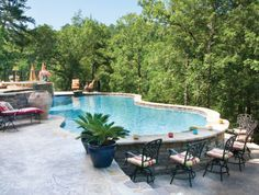 above ground pool with deck on one side and bar height seating on other