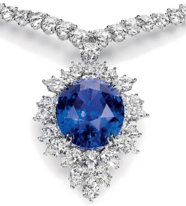 Magnificent Color Change Sapphire and Diamond Drop Necklace Oval color change sapphire, 47.41 carats; 116 marquise and pear-shaped diamonds, 45.38 total carats; platinum setting. Harry Winston.