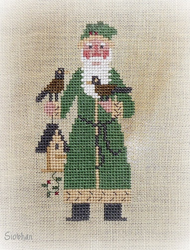 santa with birdhouse Prairie School cross stitch