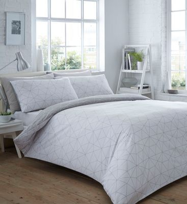 Great for introducing clean contemporary prints to any bedroom, this set from The Collection will make a stylish addition to a home interior. In a crisp white finish, it features an all-over geometric pattern with a reversible grey side.