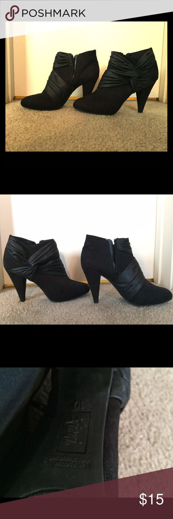 Cute black heels I have barely worn these, but they were given to me by my sister who also barely wore them. Super cute and true to size, just not my style. The heels have a little wear (shown) but otherwise great! Both zippers work perfectly. Make an offer! Fioni Shoes Heels