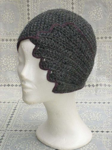 crocheted hat: I like the drama of design. It has FLAIR.... I could use some of that now for I need to think of myself in that hat,