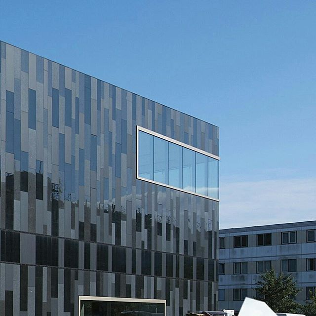 Rainscreen cladding, glass and stone, multi-faceted design #airtec. University of Potsdam.