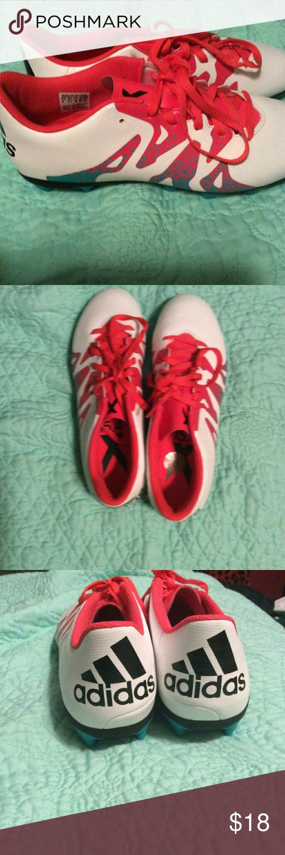 NWT ADIDAS SOCCER CLEATS The reason why it's is under NWT is because I just took the tag of yesterday and then I realized I could not return them. The are a pink/red/blue color neon. Adidas Shoes Athletic Shoes