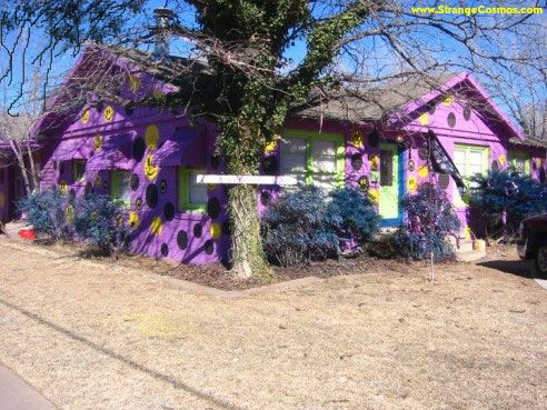 PURPLE HOUSE IN LUBBOCK TEXAS. Well its not there anymore the city made them paint it back to normal.