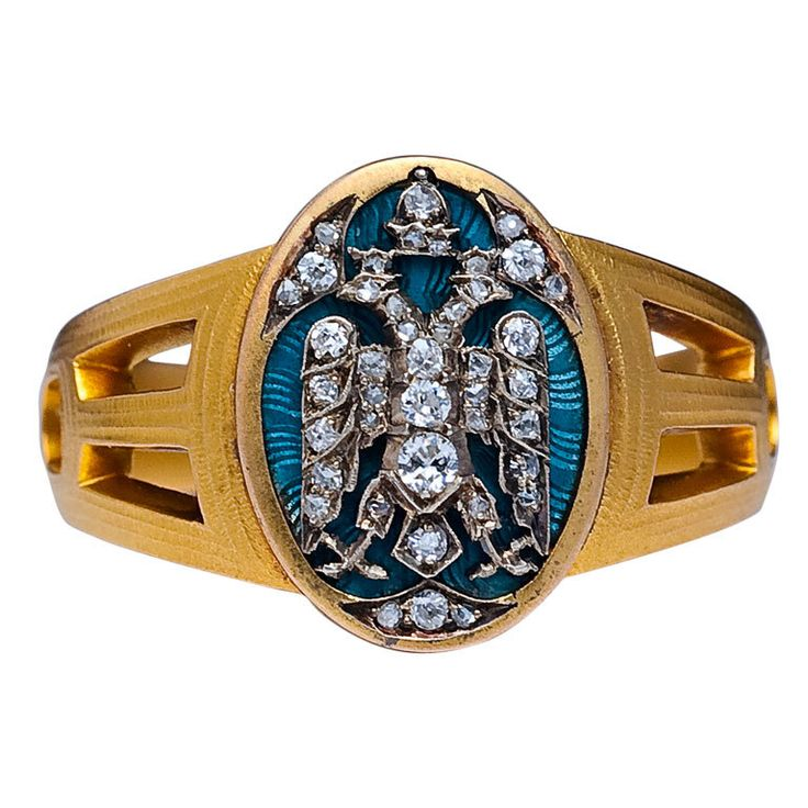 """A unique Russian Imperial Award men's ring by Faberge, given by the Empress Maria Feodorovna (mother of Tsar Nicholas II) in 1915. The ring comes with a copy of its original award certificate. The certificate is signed by the head of the Cabinet Chamberlain of His Majesty's Court with an ink seal of the Cabinet of Empress Maria Feodorovna - """"... gold ring with the State Arms embellished with diamonds"""". Circa 1915"""