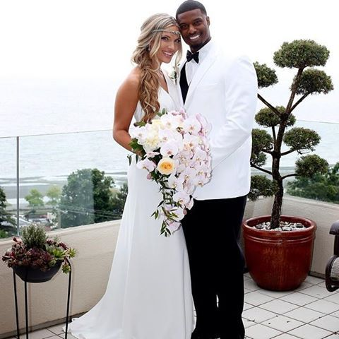 Interracial Wedding photo. Love. Bouquet. Ocean.