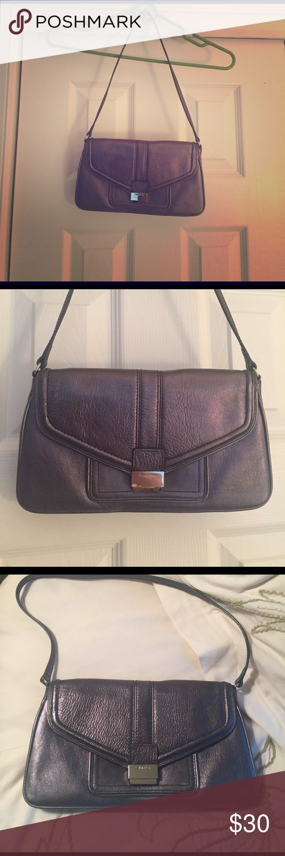 Calvin Klein Bag Metallic silver shoulder bag in excellent condition! Bag worn few times and comes with matching mirror inside. Calvin Klein Bags Shoulder Bags