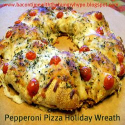 """pepperoni pizza crescent roll wreath!! yay for super easy & quick!  i think this is going to be my """"go to"""" recipe for potluck dinners now :)"""