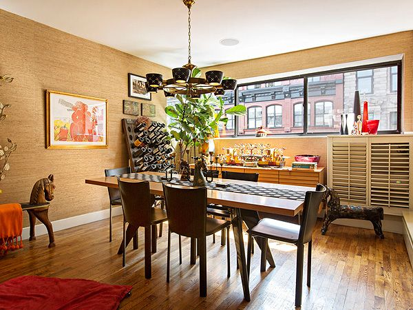 Bright and cheerful, Rachael Ray's apartment is also very personal. Much of the art has been collected from her many trips to Italy.