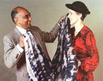 Douglas Ram Samuj with Shirley Smith, displaying fabrics he designed. The Scarf Moment has used similar fabrics by Douglas Ram Samuj.
