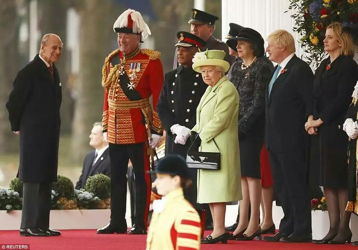 The Queen and the Duke of Edinburgh prepare to welcome the President with Theresa May, Boris Johnson and Amber Judd  Read more:http://www.dailymail.co.uk/news/article-3893006/Theresa-s-curtsy-Queen-PM-royals-welcome-Colombia-s-president-Juan-Manuel-Santos-wife-London-historic-official-state-visit.html#ixzz4OmuZNYem Follow us:@MailOnline on Twitter|DailyMail on Facebook