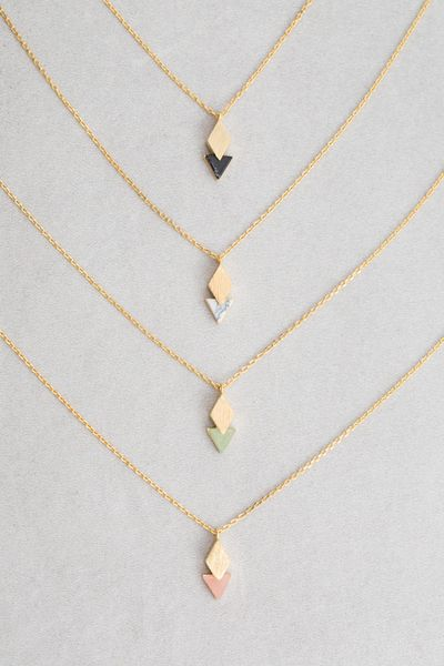 Diamond overlapping triangle stone charm necklace.