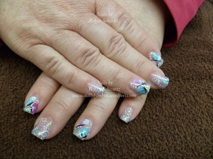Gel nails, glitter and hand painted butterflies.