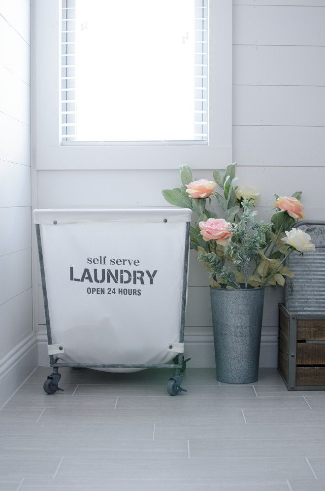 laundry design idea, hamper on wheels.  White shipshap wall paint color Snowbound by Sherwin Williams.