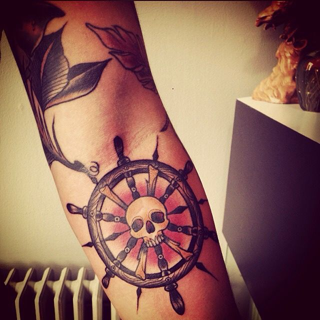 Skull ship wheel tattoo