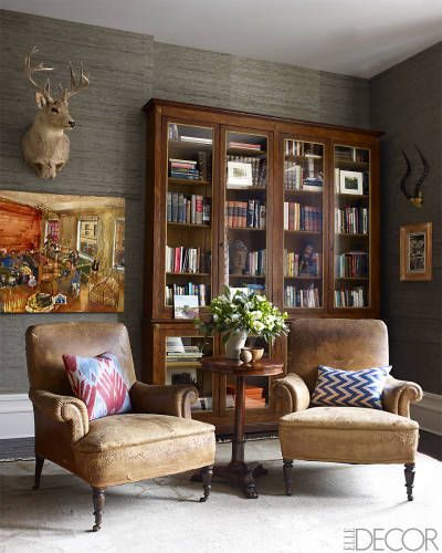 Love those chairs!!!!! Grey grasscloth. Bookcases Historic Harlem Brownstone -Sheila Bridges Harlem Home - ELLE DECOR