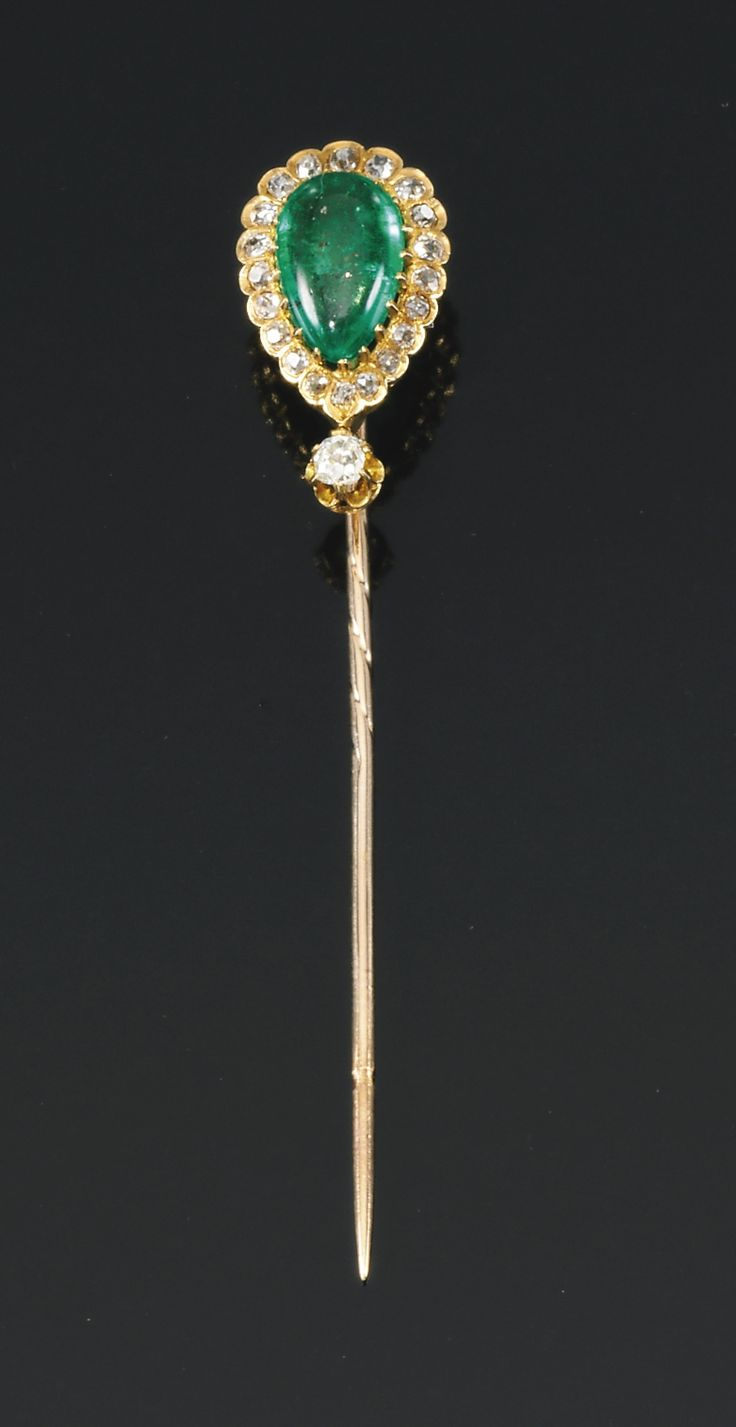 PROPERTY FROM THE ESTATE OF MARY, DUCHESS OF ROXBURGHE - Emerald and diamond stick pin, late 19th century, set with a pear-shaped emerald within scalloped surrounds of circular-cut diamonds, case stamped by J.C. Vickery.