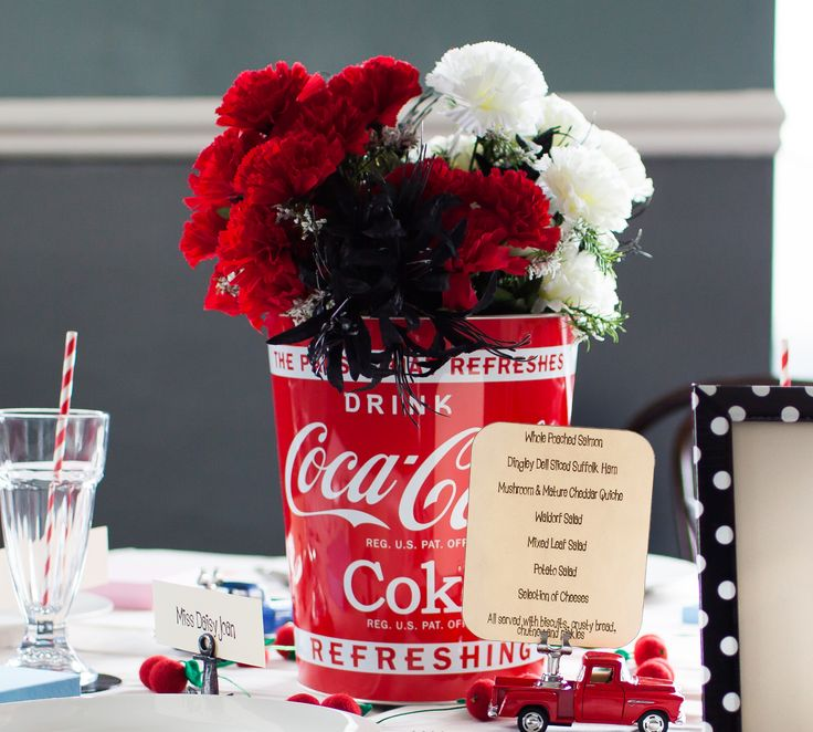The centrepiece of our Rockabilly Retro wedding package is a genuine vintage style Coca Cola ice bucket for each table - which we have used as a vase in our photoshoot but you could just as easily fill it with ice and a couple of bottles!