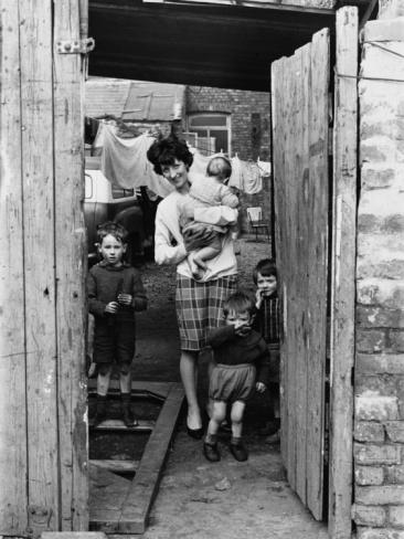 © Shirley Baker Family in the Back Garden, Manchester 1965