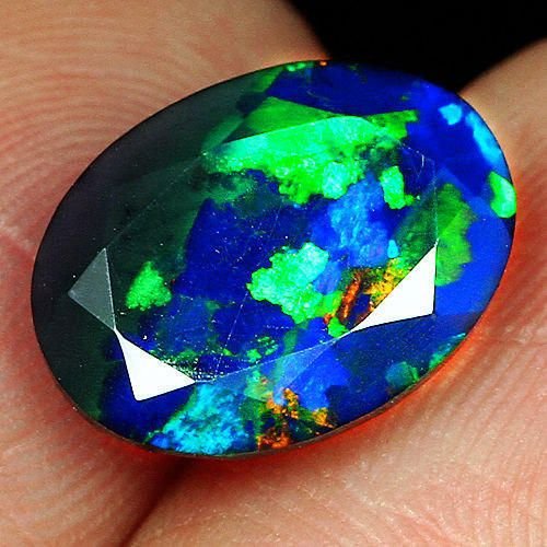 1.9CT Natural Ethiopian Black Opal Faceted Cut Play Of Color QOP2143 by StrikelineMinerals on Etsy