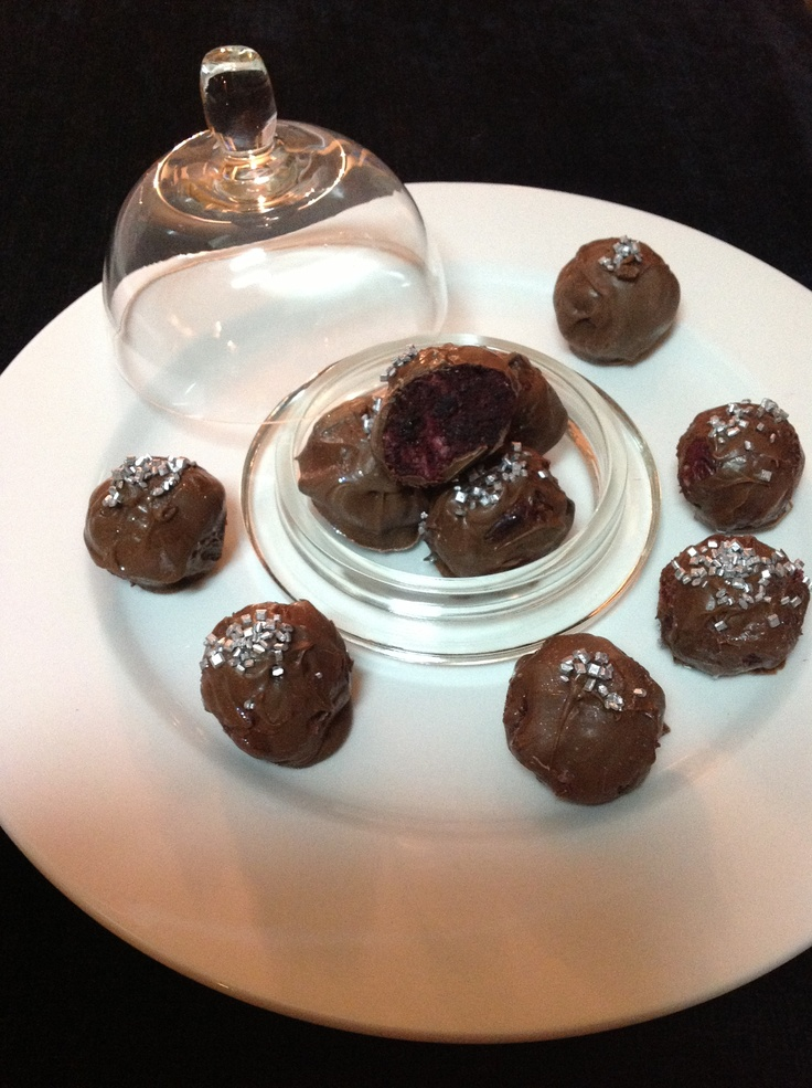 Red velvet cake balls. Leftover red velvet, mixed with cream cheese frosting, rolled into balls, then dipped in melted chocolate.