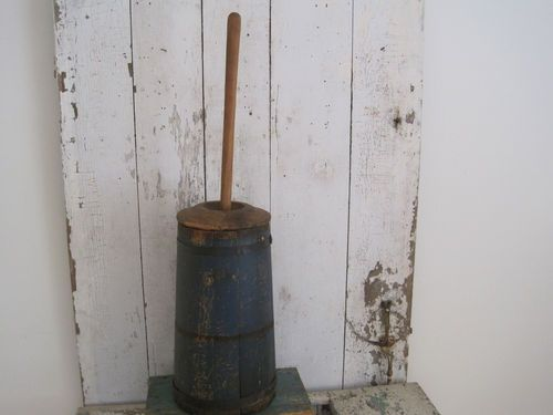 """smaller size of 19th Century Original Blue Paint Butter Churn and on the inside is a tin liner.  The top metal band has slide down with wood shrinkage and being in Very Dry Arizona. PROX: handle  height 32"""";  side height is  16 3/4"""" and side to side on the bottom is 9""""."""