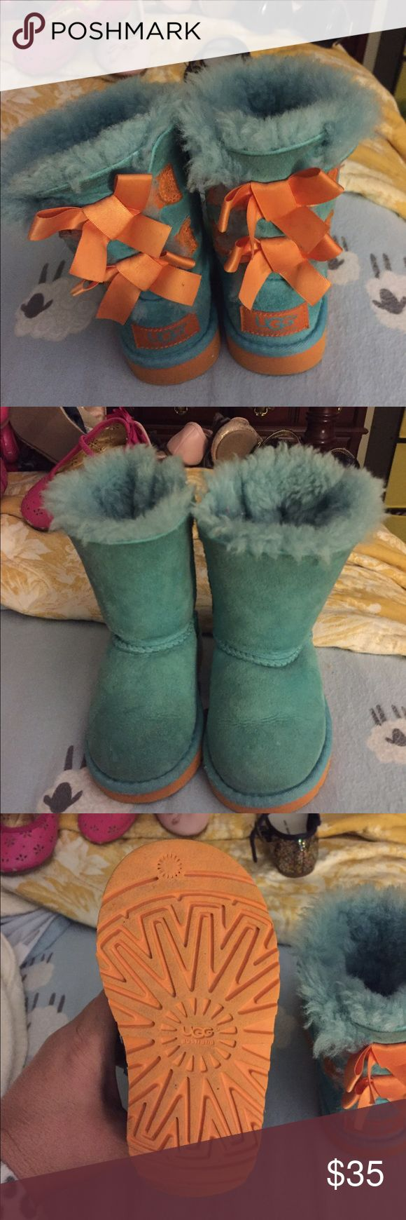 Childrens UGGs boots shearling Aqua orange lace 7 Adorable ugg boots size 7. My daughter loved these boots. They are very warm and brought so many compliments!! UGG Shoes Boots