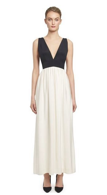 Jill Jill Stuart  Elegant double v-neck color blocked gown sits slightly high-waisted with a  softly gathered skirt with side pockets. Center back invisible zipper with hook and eye closure on top.