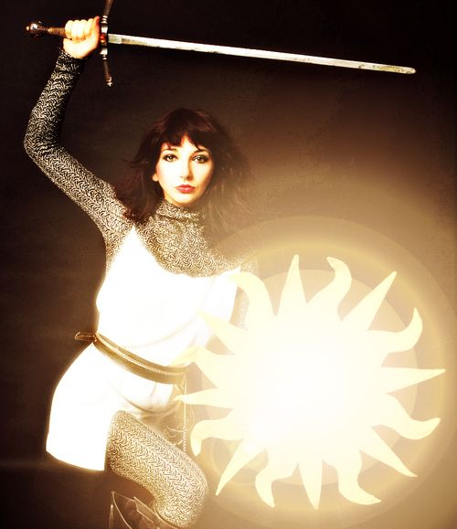 "Kate Bush - demonstrating my family motto, from an ancient coat of arms ... ""my sword, my companion"" - *divebombedintostardust*"