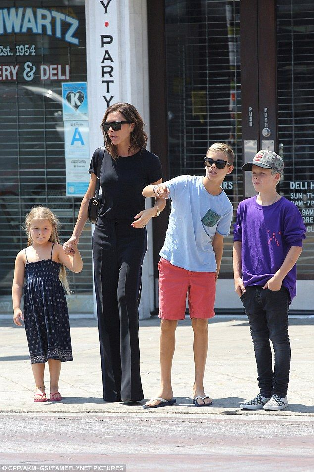 Family day out: Victoria Beckham, 42, took her three youngest - Harper, five, Cruz, 11, and Romeo, 13 - out for lunch at The Golden State, Los Angeles, on Wednesday