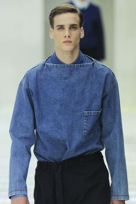 I love this jean shirt and the cut is wonderful. Is it Prada?