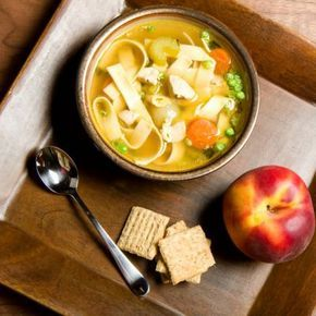 Copycat Panera Chicken Noodle Soup Recipe Soups with low-fat chicken broth, celery ribs, carrots, frozen peas, garlic cloves, onion powder, parsley flakes, dried thyme, boneless skinless chicken breasts, egg noodles, cooked and drained
