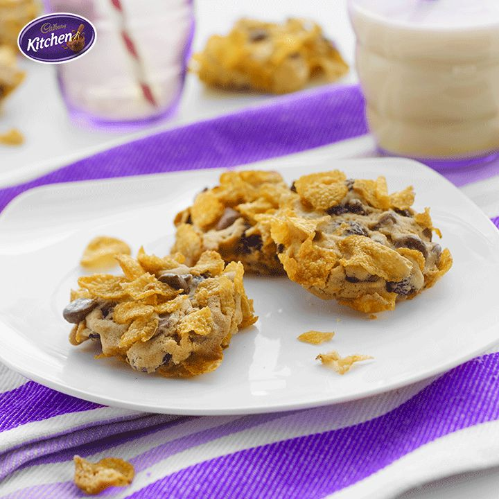 All you need? Butter, sugar, an egg, flour, sultanas, corn flakes and #CADBURY Milk #Chocolate #Baking Chips (plus, a tiny sidekick to help with measuring, mixing, and eating.) Et voila - Crunchy Cornflake #Cookies! To view the #CADBURY product featured in this recipe visit: https://www.cadburykitchen.com.au/products/view/baking-chips/