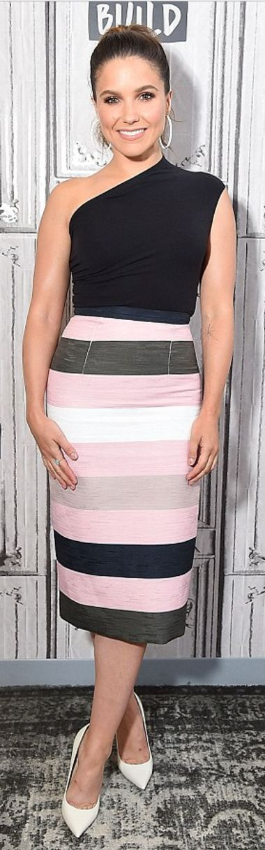 Who made Sophia Bush's white pumps, black one shoulder top, and stripe skirt?