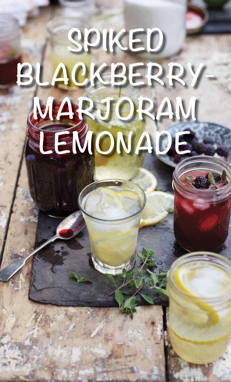 Spiked Blackberry-Marjoram Lemonade | Martha Stewart Living - You can make the boozy fruit puree up to two days in advance. Top with seltzer and garnish with blackberries, lime wedges, and marjoram leaves before serving. Recipe courtesy of Erin French, chef and owner of Lost Kitchen in Freedom, ME.