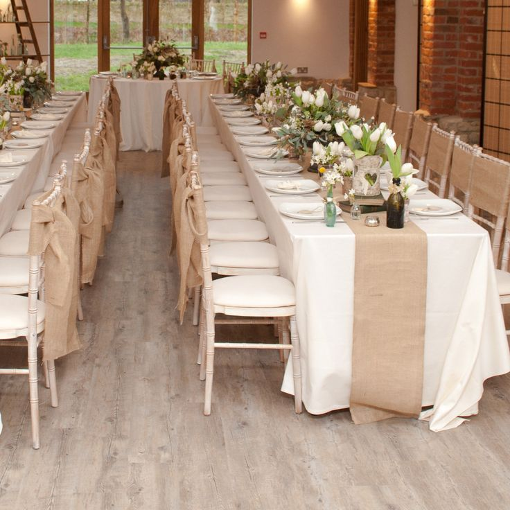 Hessian burlap fabric is perfect for country rustic weddings. Add a hessian table runner over standard white linen cloths to add a rustic touch to your wedding tables. Each hessian table runner is 2m length and 35 cm wide. If you are using this along a long top table you may need two or more runners. We also sell hessian fabric for extra finishing touches or if you would prefer to make your own hessian table runners. Our hessian table runners are sold individually.  Read our blog post…